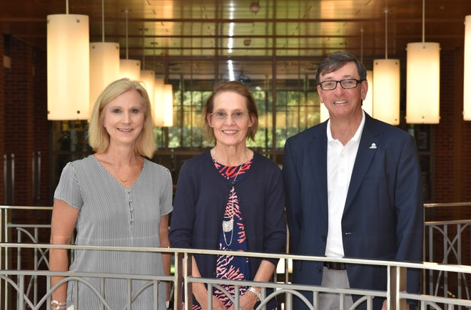 C.J. Aldrich (center) is show with Mollie Morgan, Development Officer at ASUMH, and Dr. Robin Myers, ASUMH Chancellor.