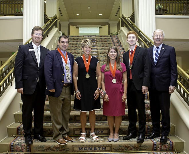 """Mountain Home High School teacher Catherine """"Cathy"""" Beckham has been named a semfinalists for Arkansas Teacher of the Year. Pictured are: (from left) Secretary od Education Johnny Key, Jeffrey Whitlow, Beckham, Melissa Spence, Joel Lookadoo and Governor Asa Hutchinson."""