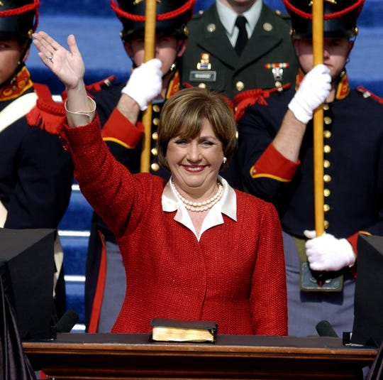 Kathleen Blanco waves after taking the oath of office as Governor of Louisiana in front of the state Capitol in Baton Rouge, Louisiana, on Jan. 12, 2004.