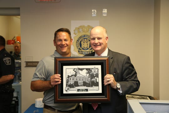 Detective Captain Bruce Dunn, left, with Morris County Sheriff James M. Gannon.