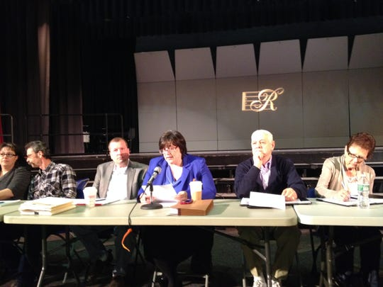 Nancy Malool, center, director of municipal consolidation and shared services for the New Jersey Department of Community Affairs Local Finance Board, conducts the first of three public hearings on a possible consolidation of Roxbury and Mount Arlington in March 2014 at Roxbury High School.