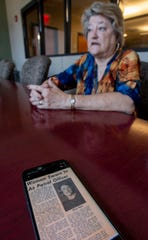 Cindy Reynolds, who retired from the Montgomery County Sheriff's Department this week, is shown in Montgomery, Ala., on Friday August 2, 2019. Before working for the Sheriff's department she retired from the Montgomery Police department. In the foreground is a Montgomery Advertiser article  from when she was the first female officer hired by the MPD.