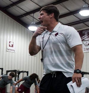 Players stretch with help from coach Granger Shook during the football Lift-A-Thon at Prattville High School in Prattville, Ala., on Thursday, Aug. 1, 2019.