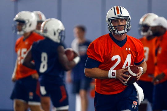 Quarterback Cord Sandberg carries the ball during Auburn's first practice, Friday, Aug. 2, 2019, in Auburn, Ala. (AP Photo/Butch Dill)