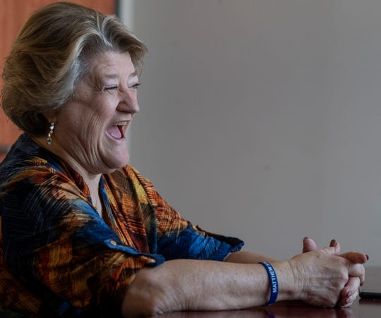 Cindy Reynolds, who retired from the Montgomery County Sheriff's Department this week, laughs while reminiscing about her career on Friday August 2, 2019, in Montgomery, Ala. Before working for the Sheriff's department she retired from the Montgomery Police department. She was the first female officer hired by the MPD.