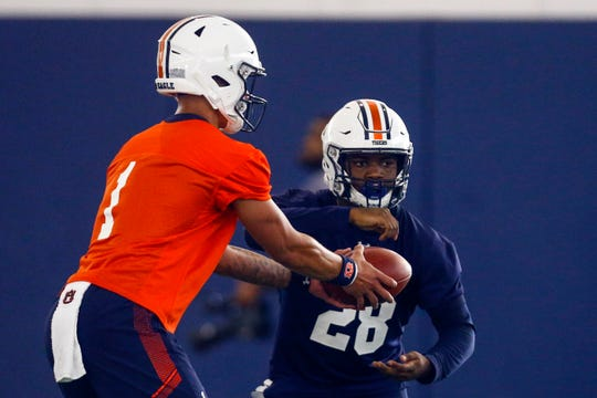Auburn backup quarterback Joey Gatewood (1) hands off to running back JaTarvious Whitlow (28) during practice on Friday, Aug. 2, 2019, in Auburn, Ala.