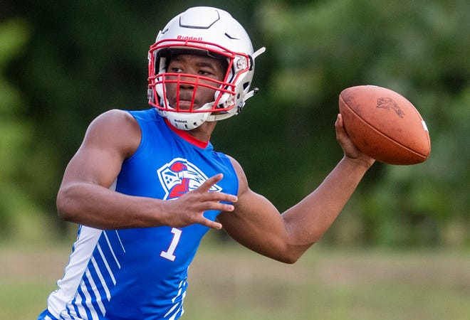 Quarterback / running back Cephus Cleveland passes during football practice at Macon East Academy in Cecil, Ala., on Thursday August 1, 2019.