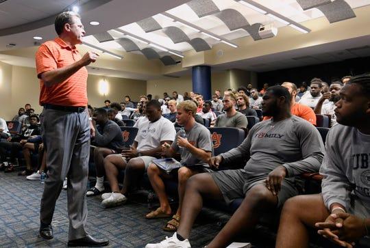 Auburn football coach Gus Malzahn talks to his players during the first team meeting of fall camp Thursday, Aug. 1, 2019, in Auburn, Ala.