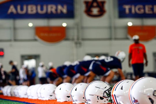 Players run drills as Auburn holds their first NCAA college football practice Friday, Aug. 2, 2019, in Auburn, Ala. (AP Photo/Butch Dill)