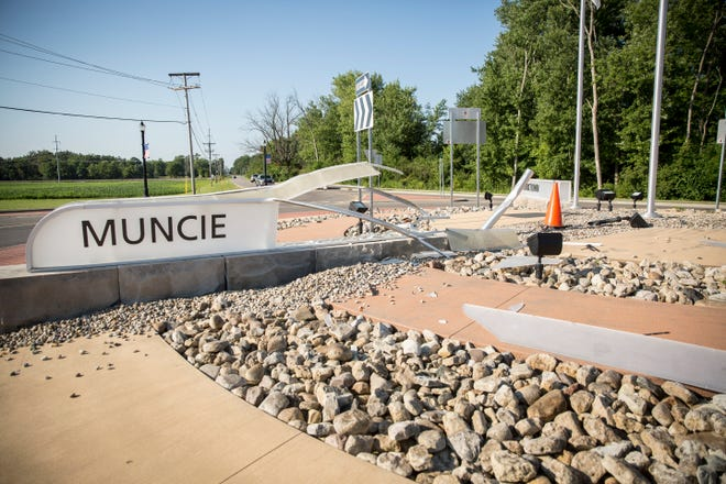 """Debris and a damaged """"Muncie Sign"""" litter the center of the Nebo Road and Jackson Street roundabout on Aug. 2 nearly two months after an early morning wreck. County officials say the sign damage may be around $45,000."""