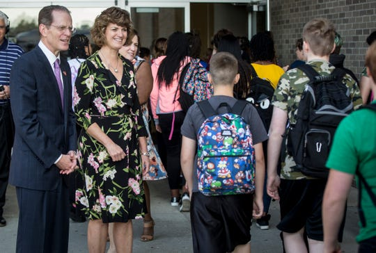 Lee Ann Kwiatkowski, the new CEO and director of public education at Muncie Community Schools, talks to students and staff as they enter the building at Northside Middle School Friday morning for the first day back to school. Kwiatkowski along with Ball State President Geoffrey S. Mearns spent time visiting schools for the first day kickoff.