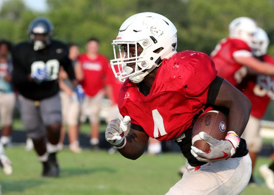 Oakland senior Jordan Brown runs the ball during a scrimmage at Cane Ridge. Brown will be out several weeks with a broken fibula.