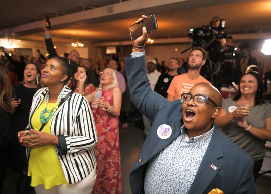 S. Prescott Harris II cheers as results come in for mayoral candidate John Cooper at the Cooper election night party at the Elks Lodge on Jefferson Street in Nashville on Thursday, August 1, 2019