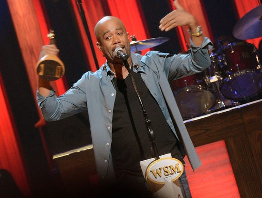 Darius Rucker gets emotional during his induction into the Grand Ole Opry as its newest member during a ceremony Oct. 16, 2012.