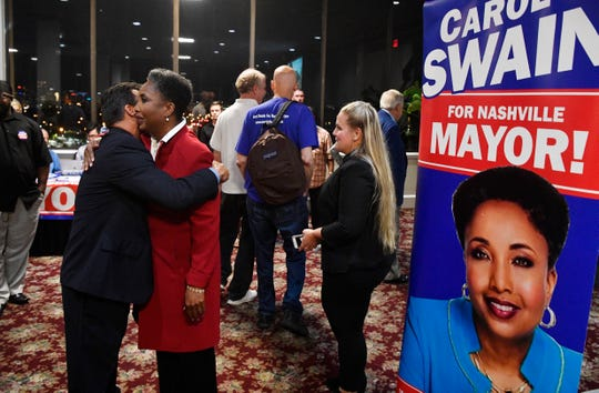 A volunteer hugs Carol Swain after she gave her concession speech at her watch party at the Millennium Maxwell House Hotel.