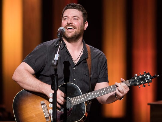 Chris Young performs as a guest of the Grand Ole Opry during a show at the Ryman Auditorium on Aug. 29, 2017.