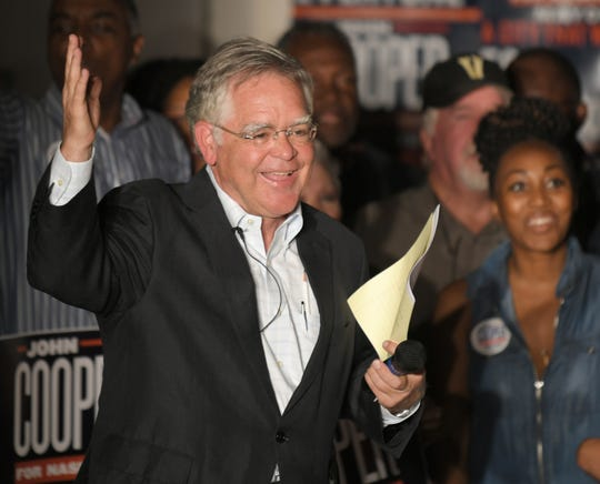 Mayoral candidate John Cooper interacts with supporters during an election night party at the Elks Lodge on Jefferson Street in Nashville on Aug. 1.