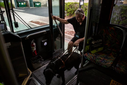 John DiMarco, who is the Chairman of Collier CountyÕs Public Transit Advisory Committee, gets on the Route 13 with his guide dog, Shadow, at the bus station of Bayshore Dr and US 41 on Friday, August 2, 2019, in East Naples.