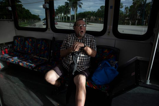 Bruce Kennedy, 68, rides on Route 13 after a grocery shopping on Thursday, August 1, 2019, in East Naples. Bruce has relied upon the buses for transportation since his car broke down about two and a half years ago.
