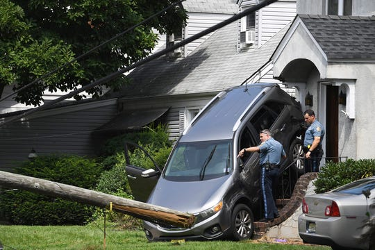 Accident on Gordon Street in Ridgefield Park on Friday, August 2, 2019. A utility pole was knocked down and a SUV hit a house.