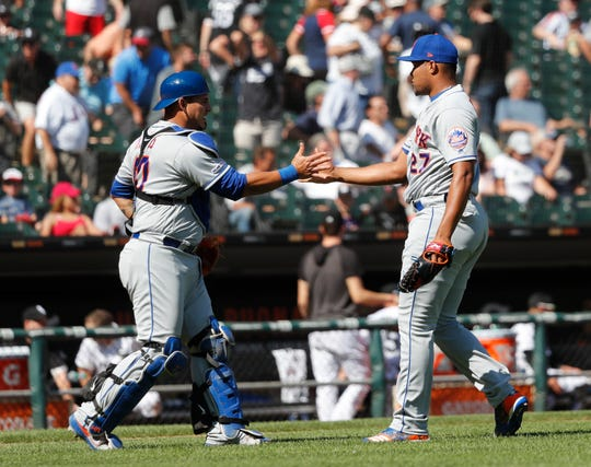 New York Mets catcher Wilson Ramos, left, and relief pitcher Jeurys Familia celebrate the team's 4-0 win over the Chicago White Sox after a baseball game Thursday, Aug. 1, 2019, in Chicago.