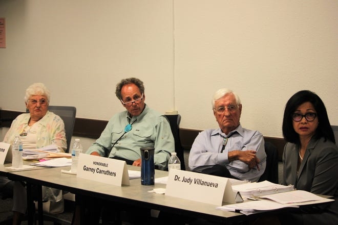 From left, New Mexico Ethics Commissioners Frances Williams, Stuart Bluestone, Garrey Carruthers and Judy Villanueva hear advice from the Department of Finance and Administration general counsel during the commission's meeting in Las Cruces on Friday, August 2, 2019.