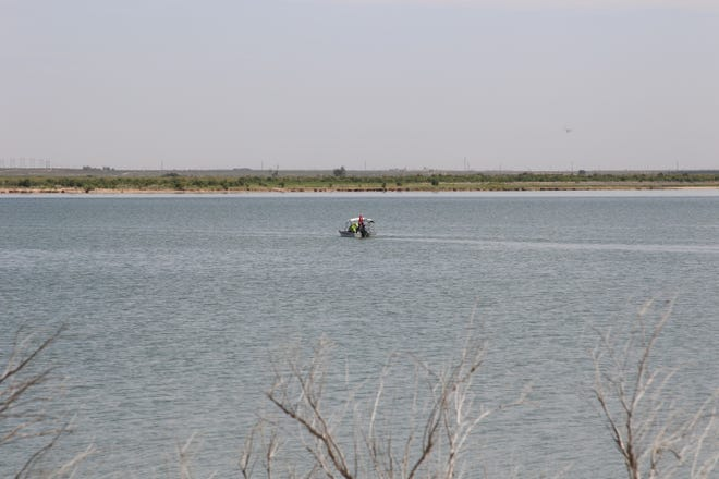 A search and rescue boat looks for the body of Vincent Dominguez July 31 at Brantley Lake State Park near Carlsbad.