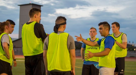 Staff Sgt. Joseph Haug, 49th Communications Squadron knowledge management supervisor, gives feedback to his teammates, July 16, 2019, during soccer practice on Holloman Air Force Base, N.M. Haug is a captain on Holloman's soccer team, and played a role in getting the team to varsity status for the first time in approximately 10 years.