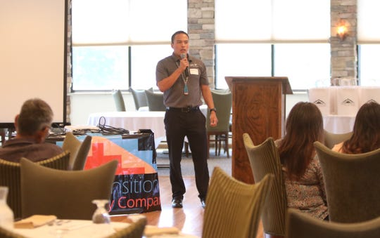Dakota Kay shares his experience in pursuing higher education on Aug. 1 during the Navajo Transitional Energy Company scholarship awards luncheon at San Juan Country Club in Farmington.