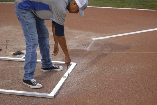 The Connie Mack World Series grounds crew prepares the field for another baseball game.
