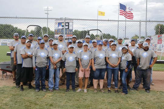 The Connie Mack World Series grounds crew poses before heading out to the field for another maintenance run.