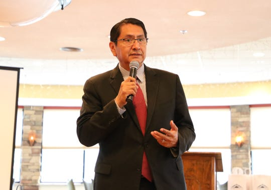Navajo Nation President Jonathan Nez talks about an effort to expand the tribe's scholarship program on Aug. 1 at the Navajo Transitional Energy Company scholarship awards luncheon at San Juan Country Club in Farmington.