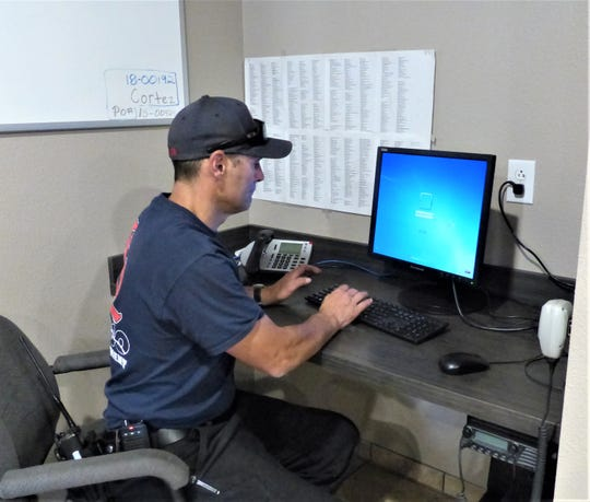 Fire fighter Sean Keller begins an assignment at the new work station in the renovated portion of Ruidoso Fire Station #2 on White Mountain Drive.