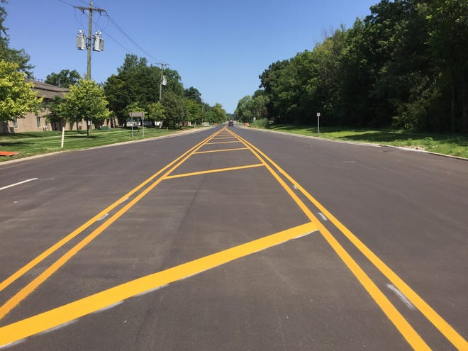 A fresh patch of asphalt covers the former bumpy area along Morton-Taylor Road in Canton Township.