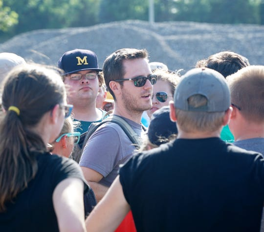 New Plymouth-Canton marching band director Mike Wells talks to his troops during an Aug. 2 rehearsal for the upcoming season.