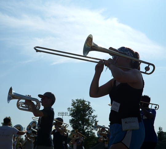 The Plymouth-Canton marching band practices on Aug. 2.