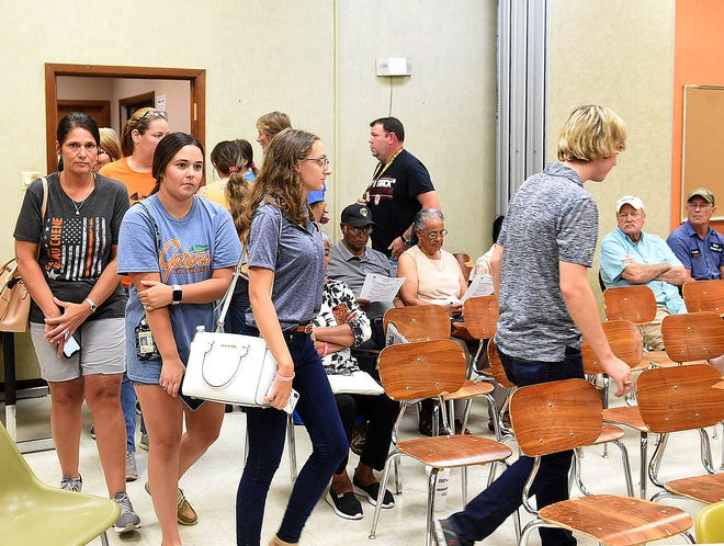 Protesters with the Save Beau Chene movement head towards a meeting of the St. Landry Parish School Board on Thursday. Members of the group say they are dissatisfied with a number of administrative policies created by principal Barbara Roberson and are asking district school officials for her removal.