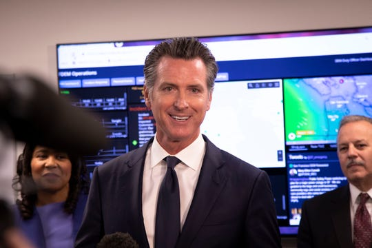 California Governor Gavin Newsom announces new upgrades to outdated 911 call centers after touring a facility in San Francisco, CA. He was joined by SF Mayor London Breed (left) and officials from the Department of Emergency Services.