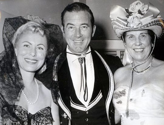 Sandy and John Payne with Hildy Crawford dressed up at Phil Regan's party.