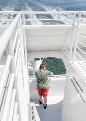 Brian Fratto, of Wyckoff, New Jersey, enjoys the view from the stern of the Pelican Perch ferry.