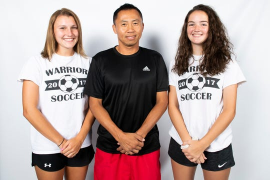 Susquehannock soccer players Ashlynn Weger (left) and Lilly Denis pose with coach Phomma Phanhthy the GameTimePA photo booth during YAIAA fall sports media day in Hanover on Friday, August 2, 2019.