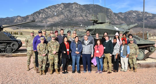 Educators and community partners attending the Phoenix Recruiting Battalion's Educators Tour, pose for a group photo, March 27, Fort Carson, Colo.