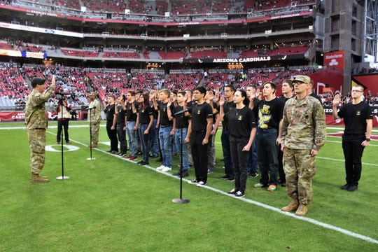 Nov. 18, State Farm Stadium, Glendale, Ariz. The mass enlistment ceremony took place shortly before a National Football League game between the Arizona Cardinals and Oakland Raiders.