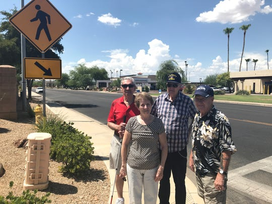Sun City West residents (front from left) Gloria Dingley, Vince Blowers, (back from left) Warren Convoy and Bud Flavin stand at the intersection of 138th Street and Woodside Drive, down the street from their homes.