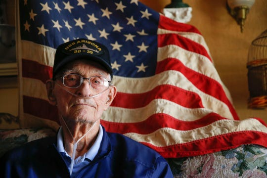 """In this July 11, 2018 photo, Pearl Harbor survivor and WWII veteran Lonnie Cook poses for a portrait at his home in Morris, Oklahoma. Lonnie David """"L.D."""" Cook was one of the last known survivors of the U.S.S. Arizona during the 1941 Japanese attack on Pearl Harbor. He died  July 31, 2019 at age 98."""