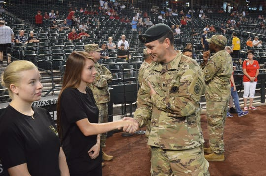 Lt. Col. Scott Morley, commander, Phoenix Recruiting Battalion, shakes the hand of a Future Soldier, prior to a mass oath of enlistment ceremony conducted by the battalion, Aug. 26, Chase Field, Phoenix.