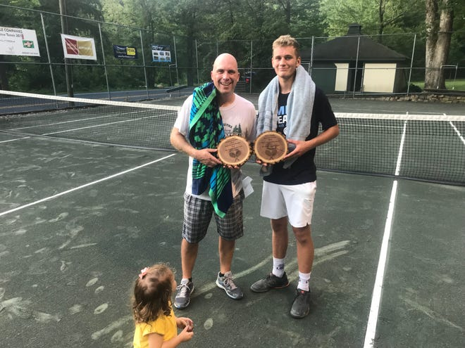 2019 Mt. Gretna singles champ Ben Clary, right, and runner-up Mike Rohrbach pose with their trophies as Rohrbach's daughter Anna moves in for a photo bomb.