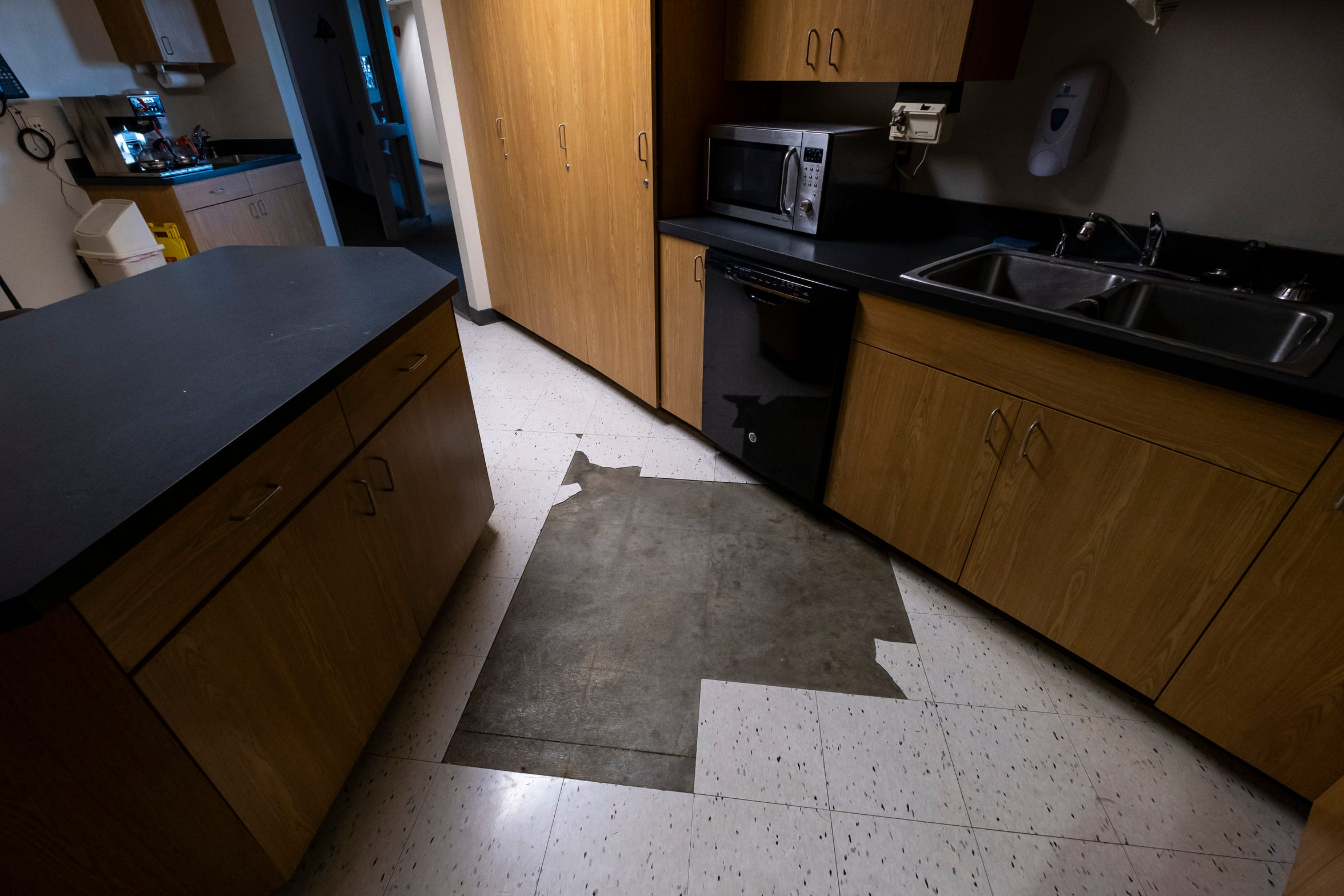 Floor tiles were removed in the Marysville Public Safety building due to moisture getting under them.