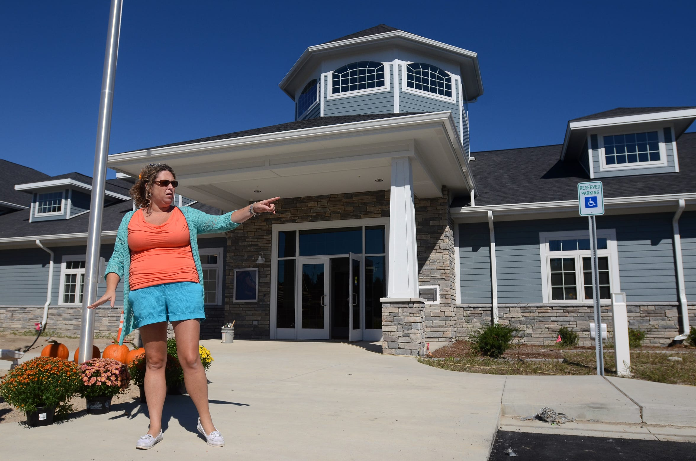 Former township supervisor Jorja Baldwin talks about the last remaining work that needed to be done Monday, Sept 21, 2015, at the new Fort Gratiot township hall on Keewahdin Road.