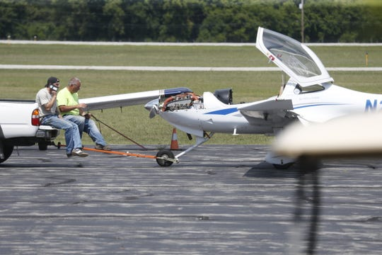 An aircraft with reported malfunctioning landing gear touches down safely at Hudson Valley Regional Airport on August 2 2019.